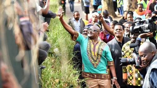 Gauteng Premiere David Makhura greets learners during Africa Day celebrations