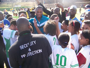 Didier Drogba greets learners